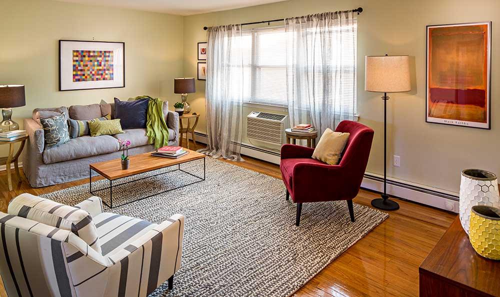 Quail Ridge Apartments living room with hardwood floors