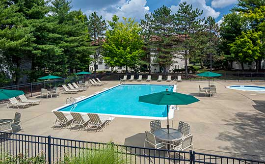 Relax in the Quail Ridge Apartments community pool