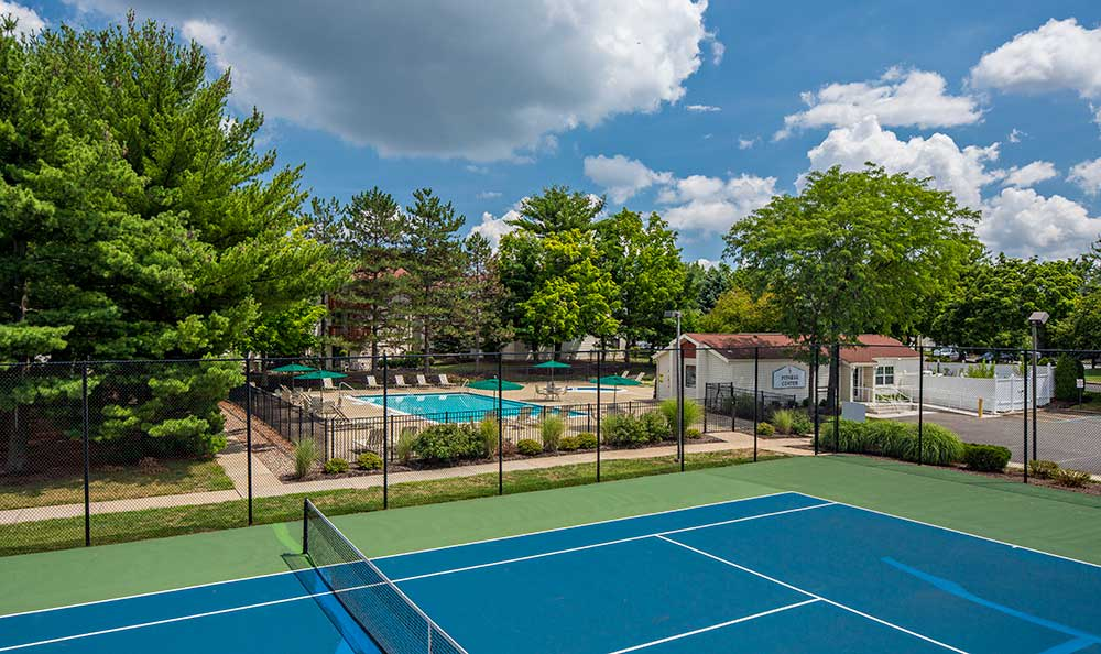 Tennis courts and pool at Quail Ridge Apartments
