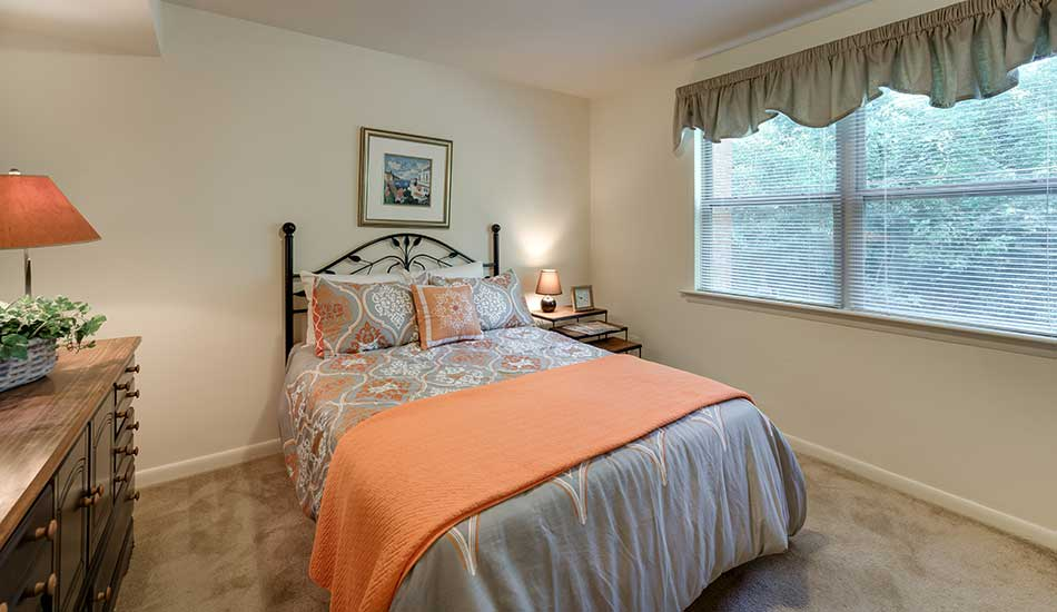 Master bedroom at Arbor Oaks Apartments