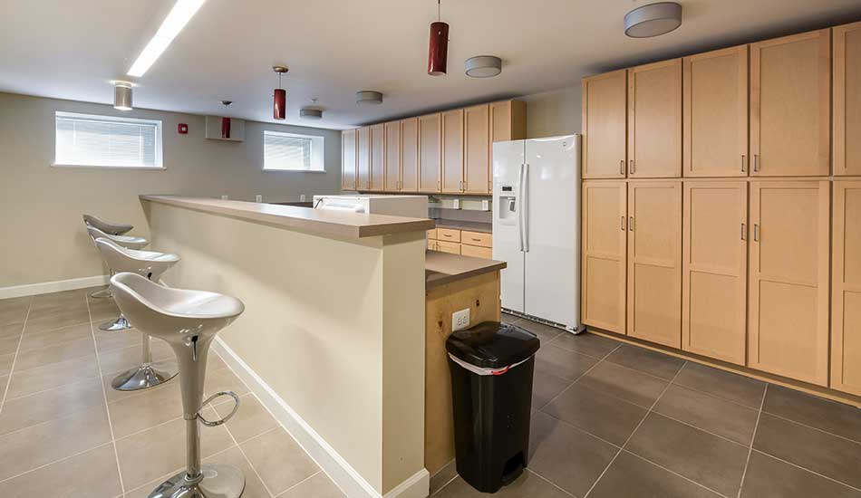 Clubhouse kitchen at Columbus School Apartments