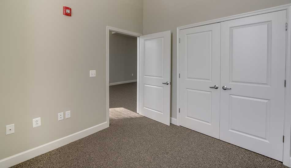 Large bedroom at Columbus School Apartments