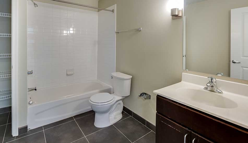 Columbus School Apartments with tiled bathroom
