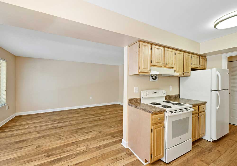 Kitchen and living room at EastView Communities have hardwood floors