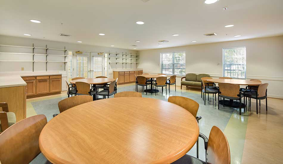 Community center tables at Edmondson Commons