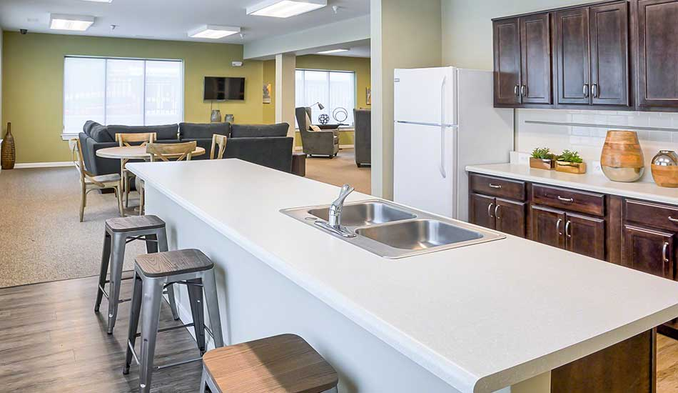 Resident lounge with kitchen at Fulton Gethsemane Village