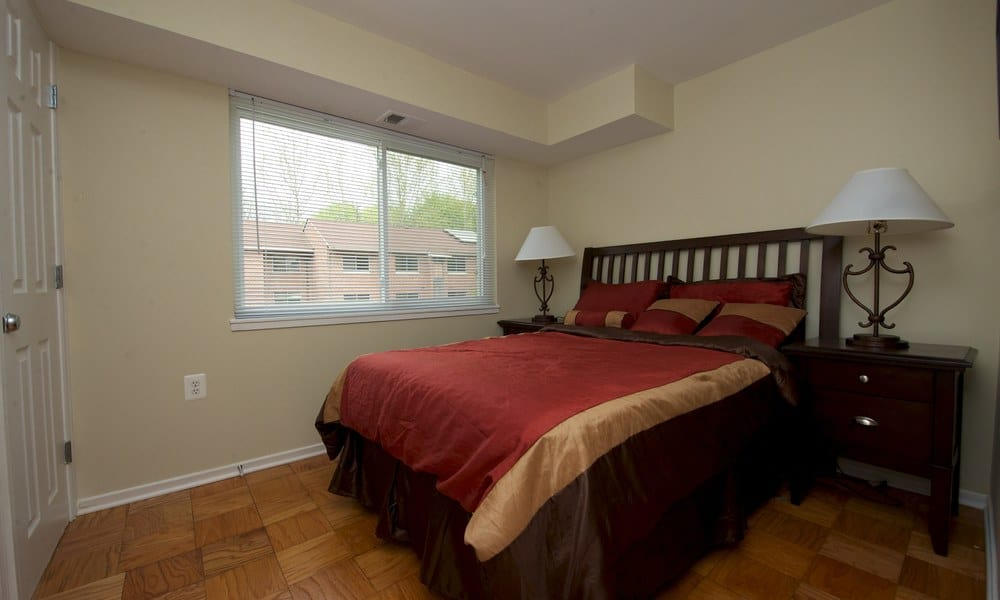 Well lit bedroom at Stony Brook Apartments