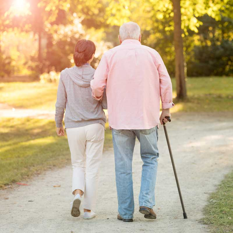 Elderly couple going to a walk