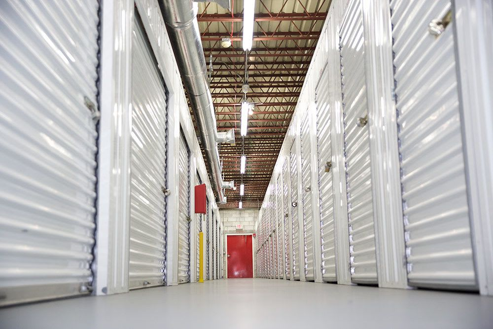Interior view of clean and bright hallways at American Personal Storage in Port St Lucie