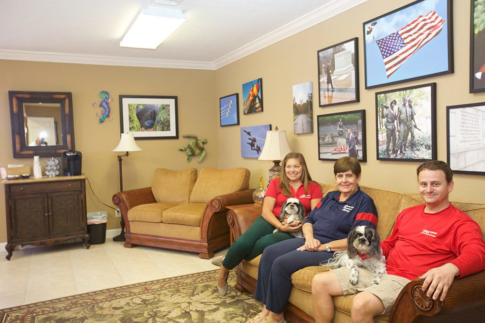 Friendly staff (and their four-legged friends) at American Personal Storage in Port St Lucie