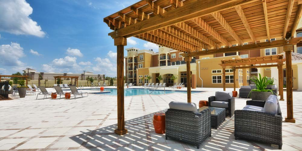 Poolside pergola offers shade at The Gate Apartments