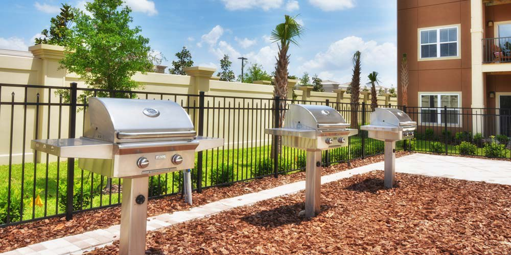 Poolside grilling area at The Gate Apartments