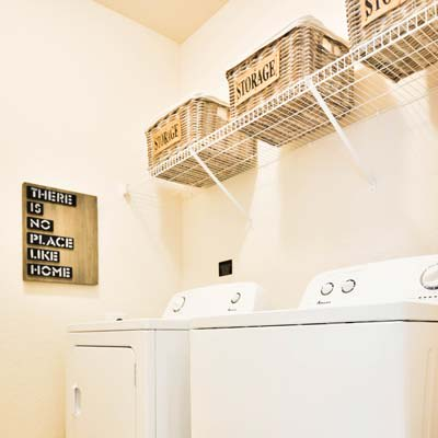 Laundry room view in model home at The Gate Apartments