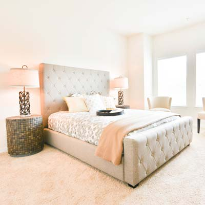 Gorgeous model home's bedroom at The Gate Apartments in ChampionsGate