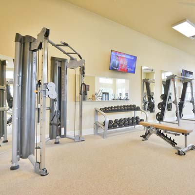 Another view of the fully equipped fitness center at The Gate Apartments