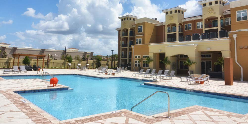 Sparkling swimming pool view at The Gate Apartments in ChampionsGate