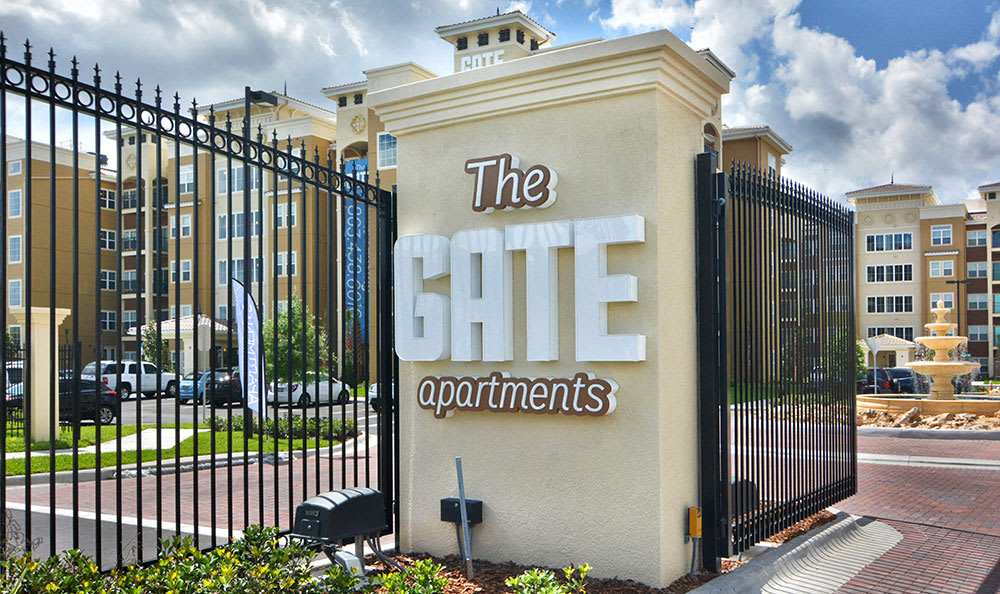 The Gate Apartments sign
