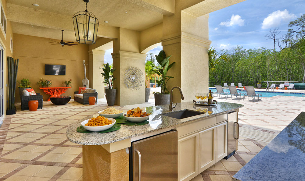 Convenient and well-equipped outdoor kitchen and bar at The Gate Apartments in ChampionsGate