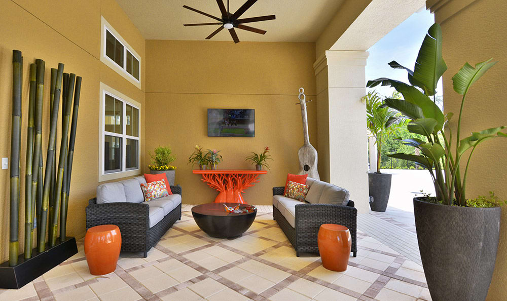 Comfortable and beautifully decorated outdoor shaded common areas at The Gate Apartments
