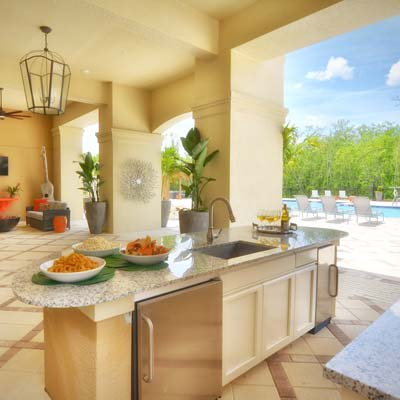 Outdoor cabana and kitchen, poolside at The Gate Apartments