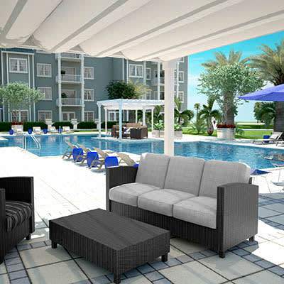 Resort Style Pool And Seating At The Avenue Apartments