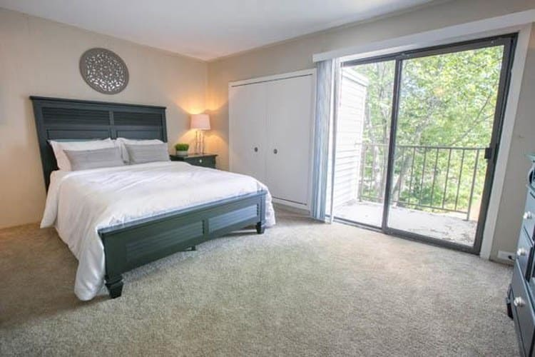 Cozy bedroom at Whitewood Apartments in Twinsburg, Ohio