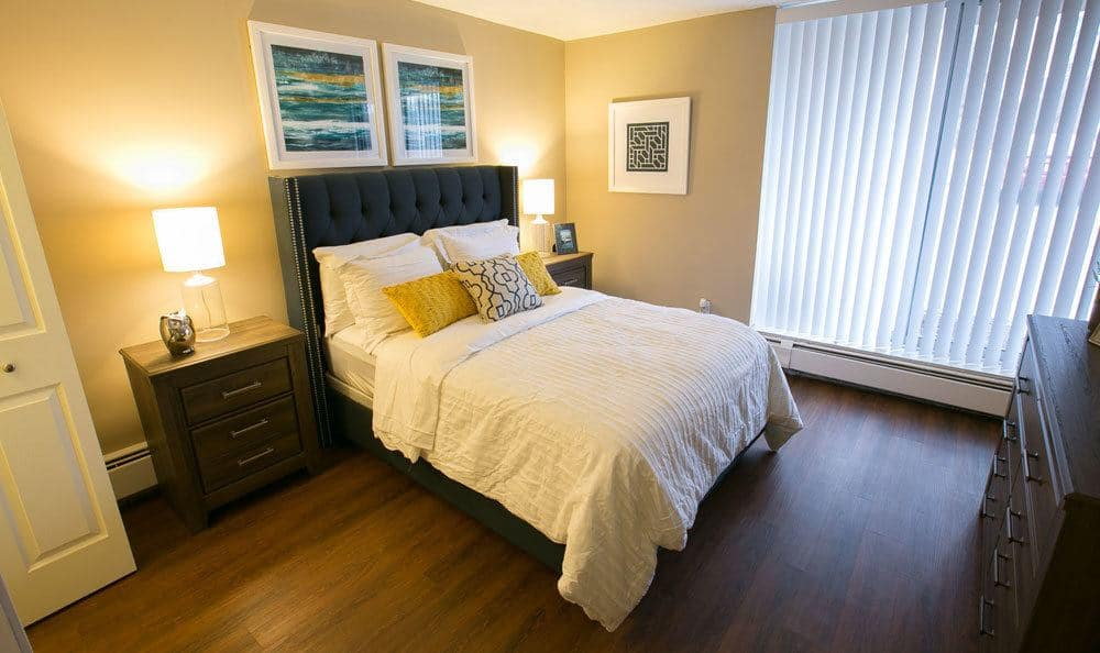 Model bedroom at Solon Club Apartments in Oakwood Village, OH