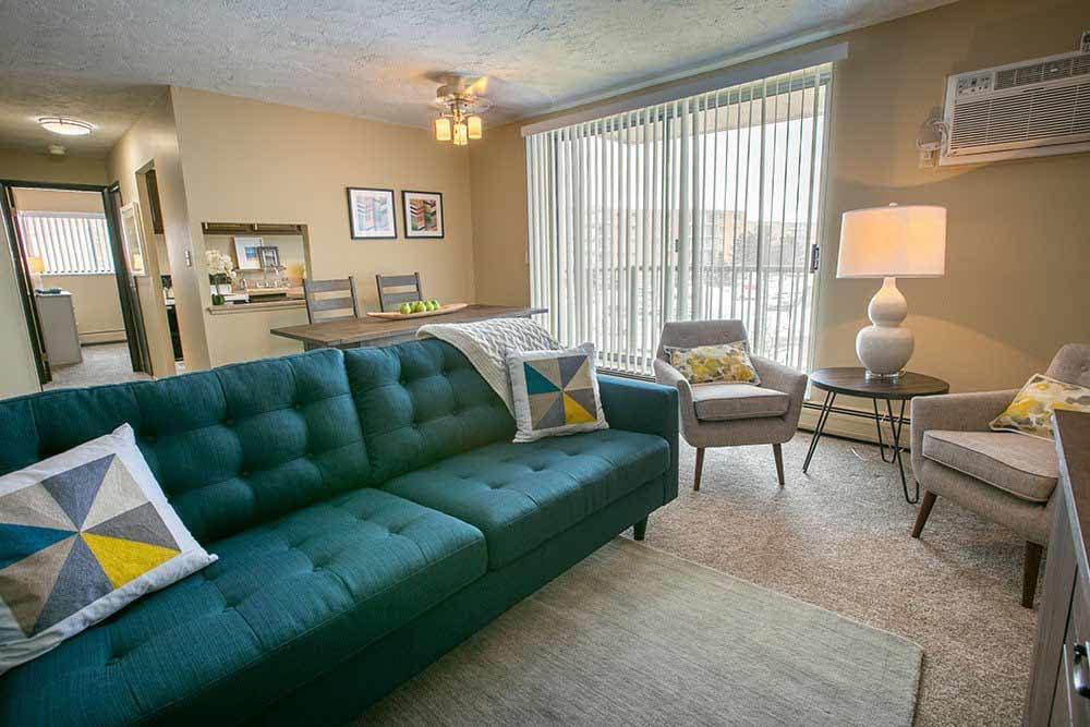 Bright inviting living room at The Drake Apartments