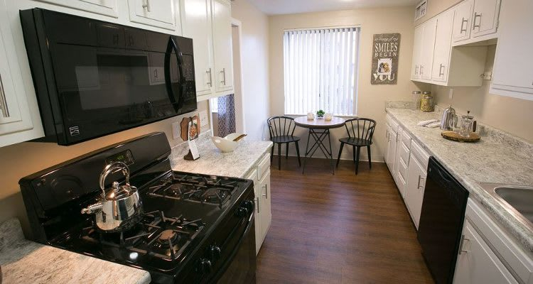 Deville Apartments offers a modern kitchen in Beachwood, Ohio