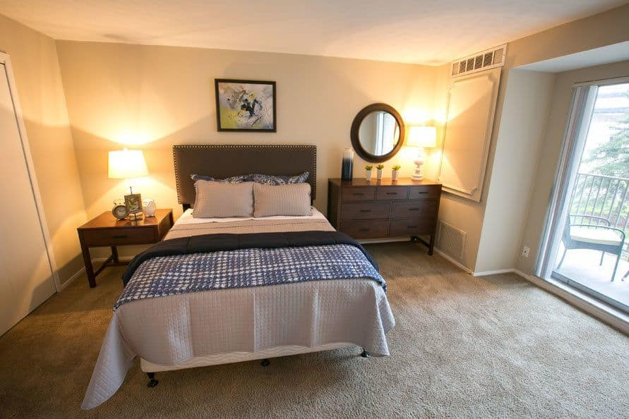 Bright inviting bedroom at Deville Apartments