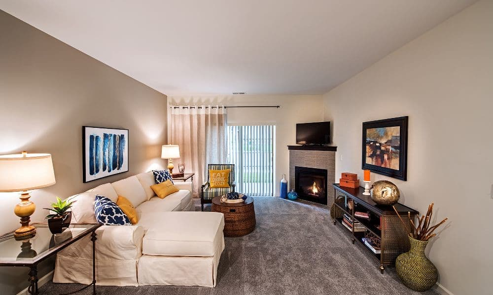 Well decorated living room at Eden Square Apartments