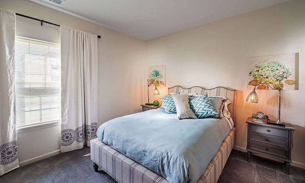 Beautifully designed bedroom at Eden Square Apartments