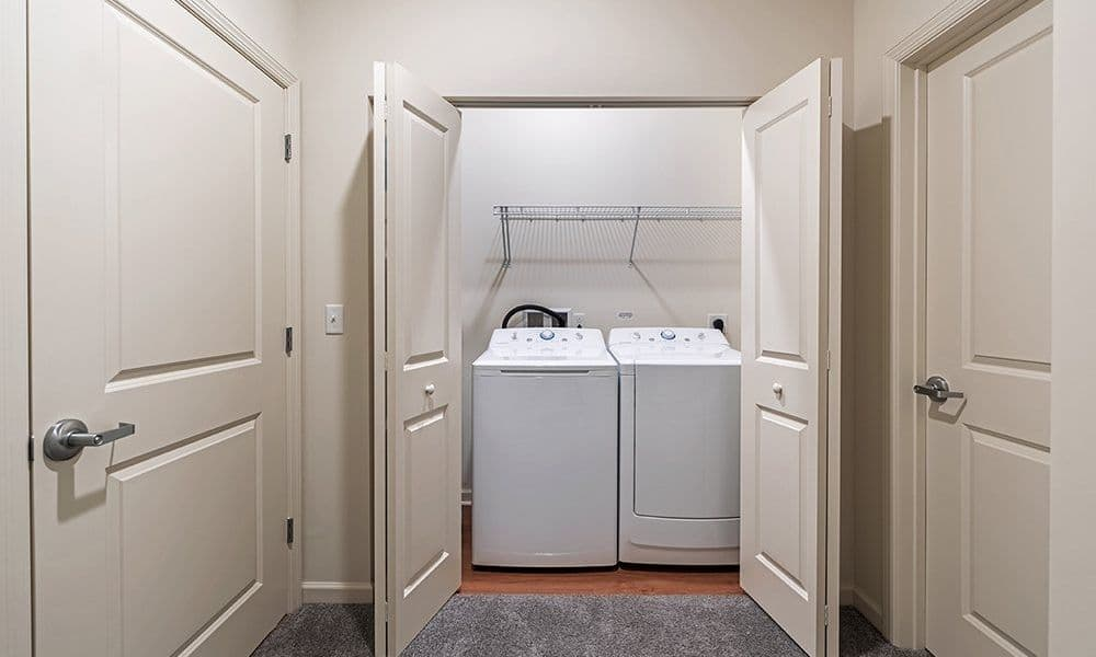 Laundry room at Eden Square Apartments