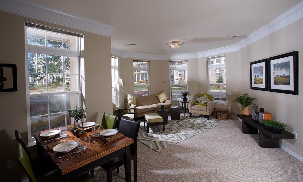 Enjoy family time in your spacious living room at Worthington Luxury Apartments