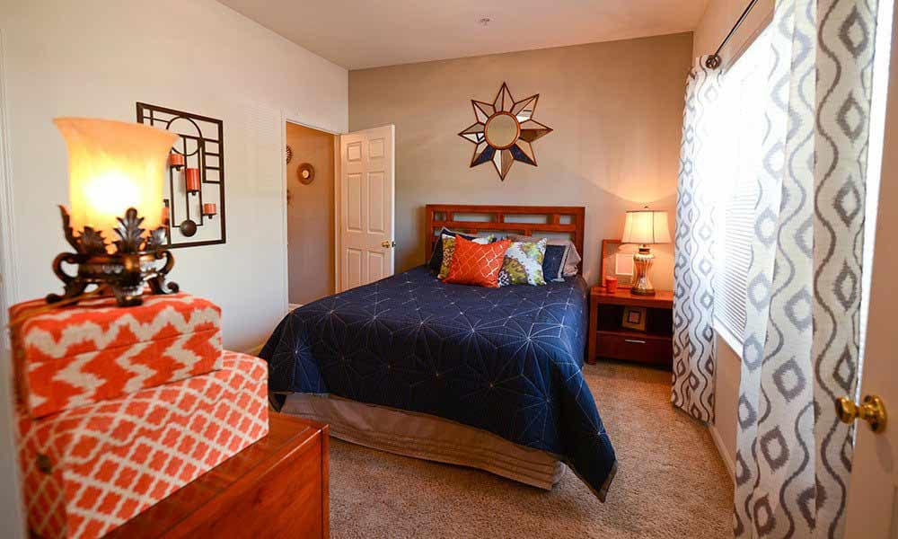 Bright inviting bedroom at The Waterfront Apartments