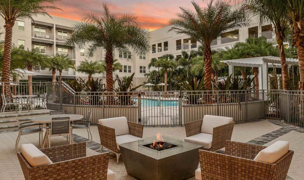 Seating and a cozy fireplace at CitySide Apartments in Sarasota, FL