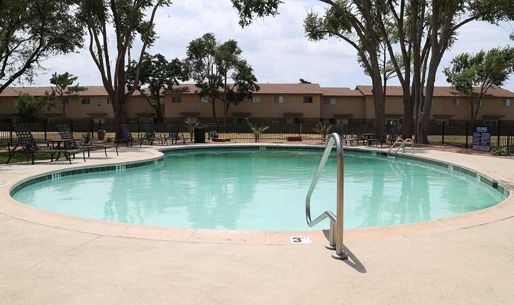Stay cool in the Texas heat in the pool at Park Square Apartments