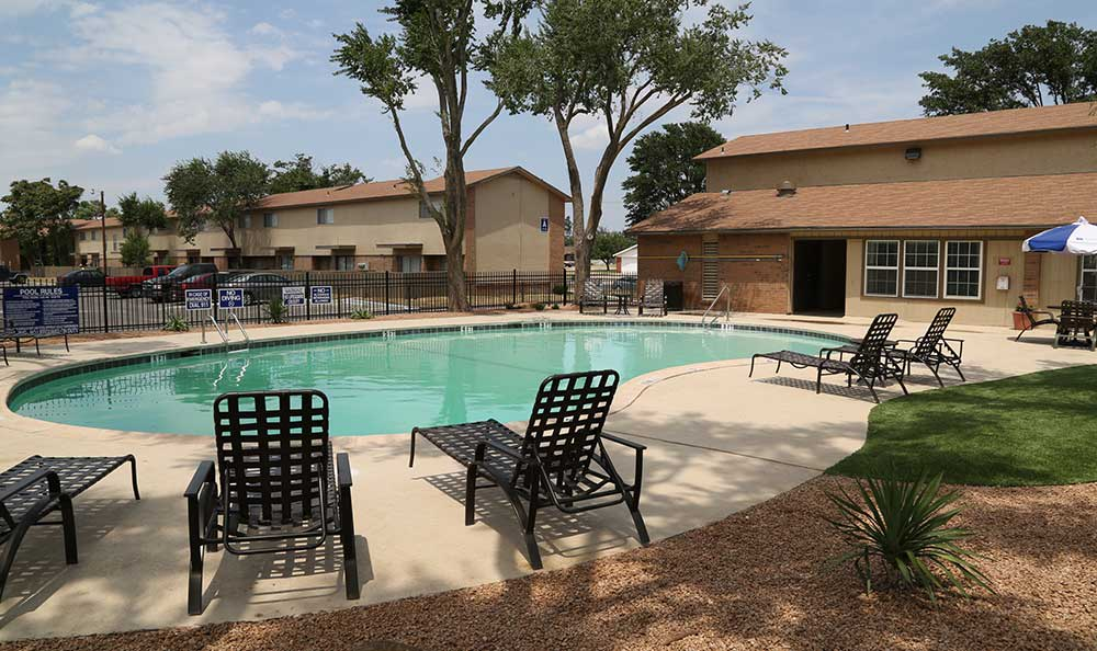 A pool is one of the many great community amenities at Park Square Apartments