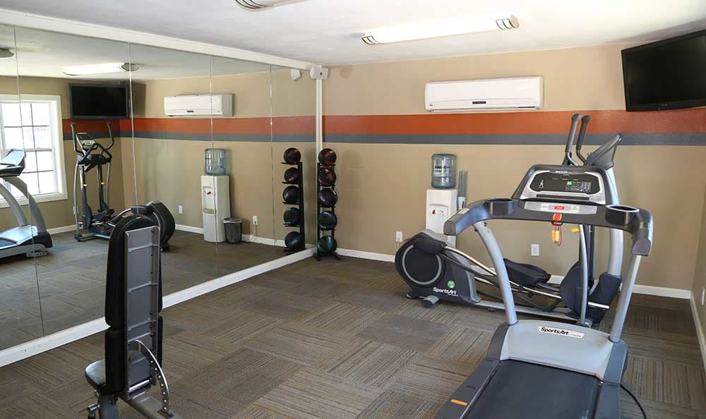 The fitness center at Sunset Apartments