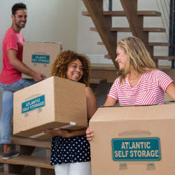 New Atlantic Self Storage student customers moving their items in at our Saint Johns facility
