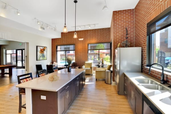 Community clubhouse with seating and kitchen at The Parc at Greenwood Village in Greenwood Village, Colorado