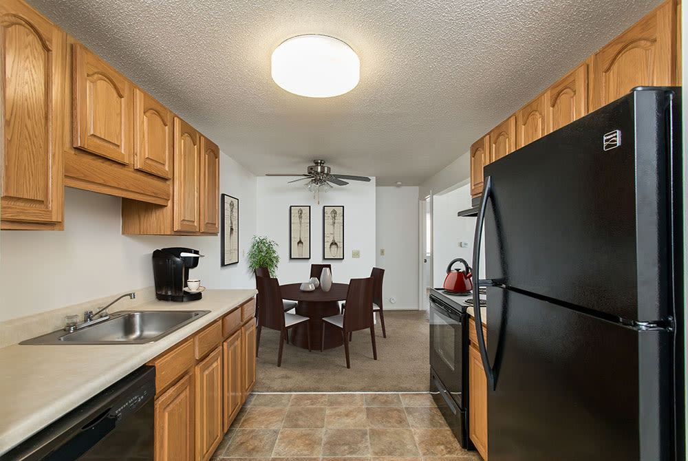 Fully-equipped kitchen at Perinton Manor Apartments in Fairport