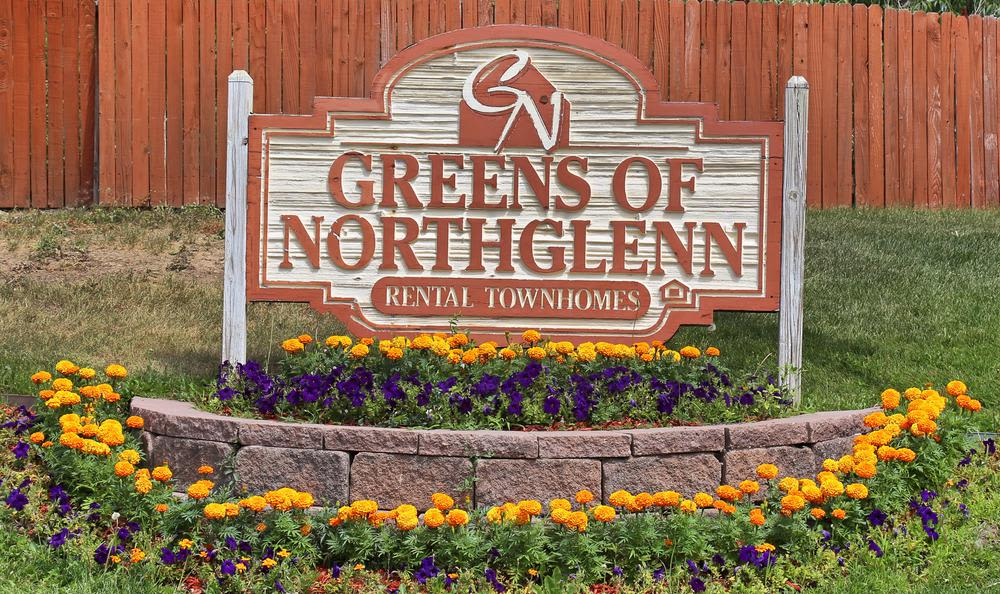 Welcome Sign to Greens of Northglenn Apartments In Northglenn CO