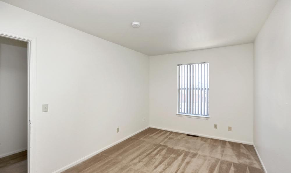 Spacious bedroom at Greens of Northglenn Apartments in Northglenn, Colorado