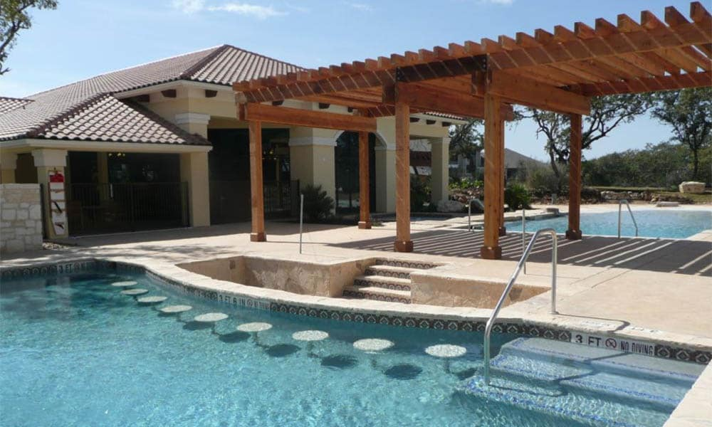 Poolside lounge at Pecan Springs Apartments