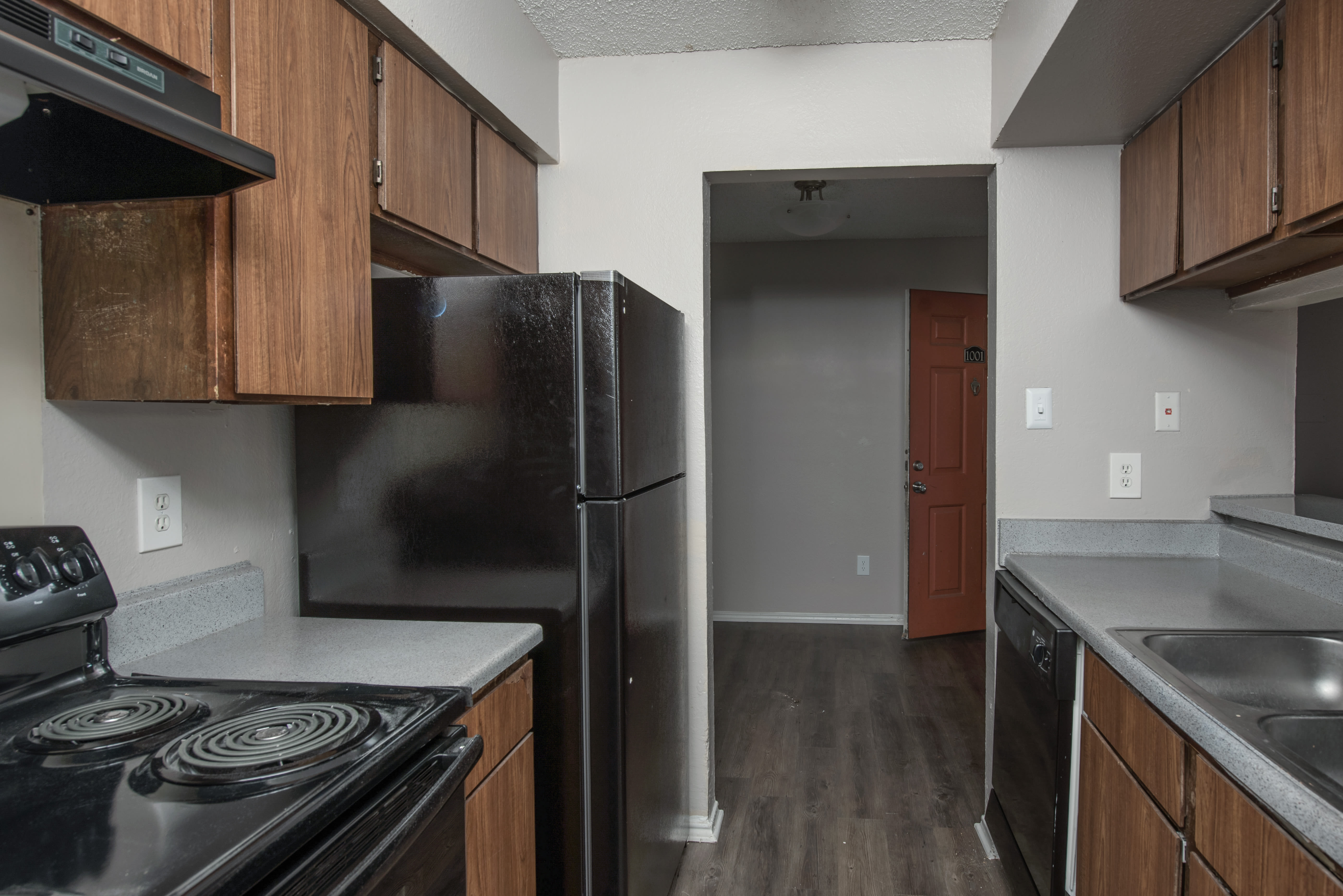 Kitchen with black appliances at Churchill Crossing Apartments