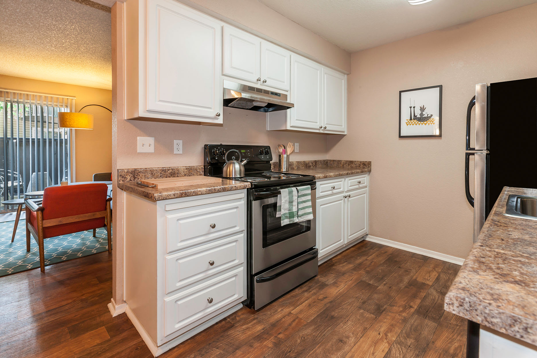 Kitchen and Living Room at The Woodlands Apartments in Sacramento