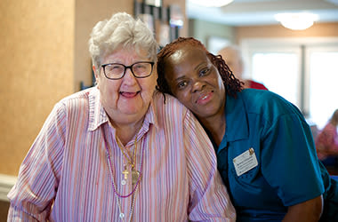 Resident and caregiver at Clermont Park in Denver