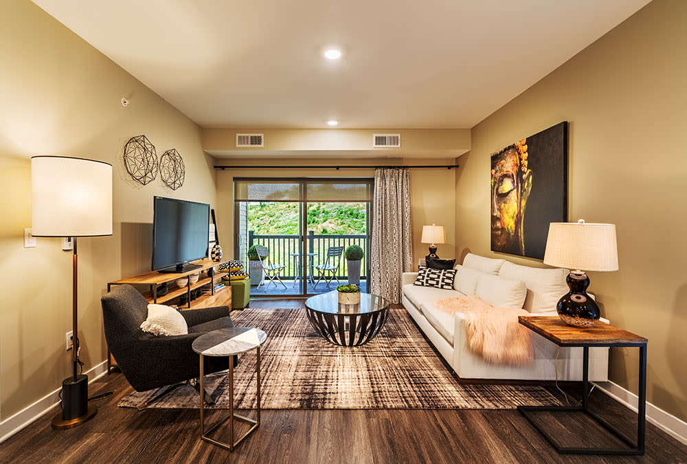 Pittsburgh apartments includes living rooms with attached patios