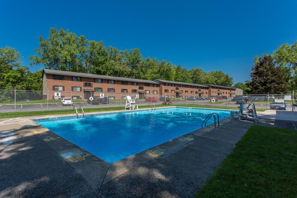 Sparkling swimming pool at The Residences at Covered Bridge in Liverpool, NY
